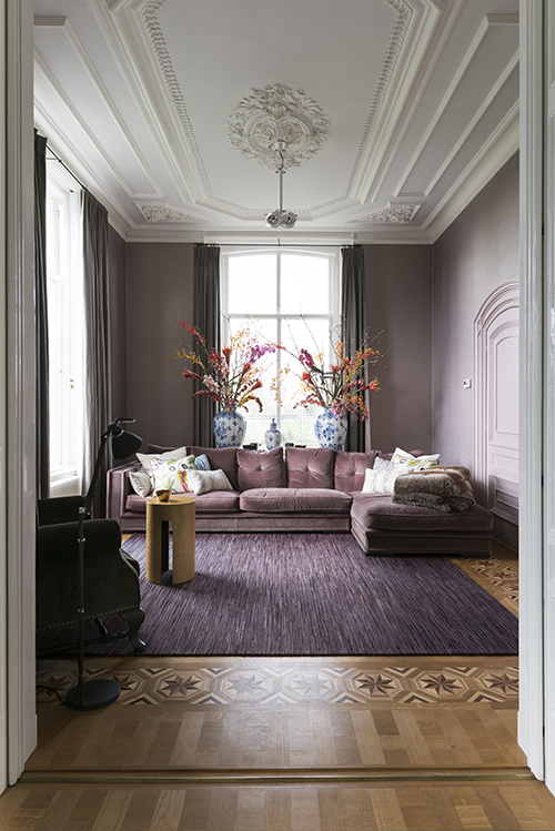 Completely restored ceilings in the livingroom hued in a subtle violet grey.