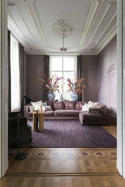 Completely restored ceilings in the livingroom hued in a subtle violet grey.