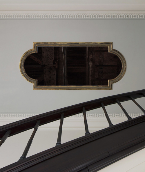 The restored and newly gilded 19th c. frame in the ceiling,<p> allowing one last glimpse at the beams in the attic, moments before the new ceiling painting is installed.
