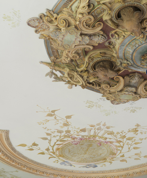 Boars, bears, dogs and deer; restored 19th century polychrome plaster ornaments on the ceiling.