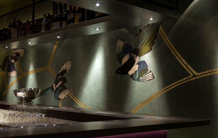 In the loungebar Korver has painted four more of these birds, now blown to almost man-sized proportions.
