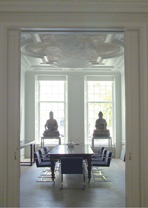 """Two 8th century Chinese sculptures overlook the meeting tables in the frontroom of the house. <p> Elegant Mies van der Rohe \""""Brno\"""" chairs available to sit and look up to the largest of these twin painted ceilings."""
