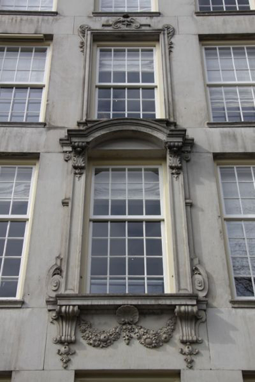 Like lacework. The beautifully ornamented limestone façade dating from the 1740\'s. .
